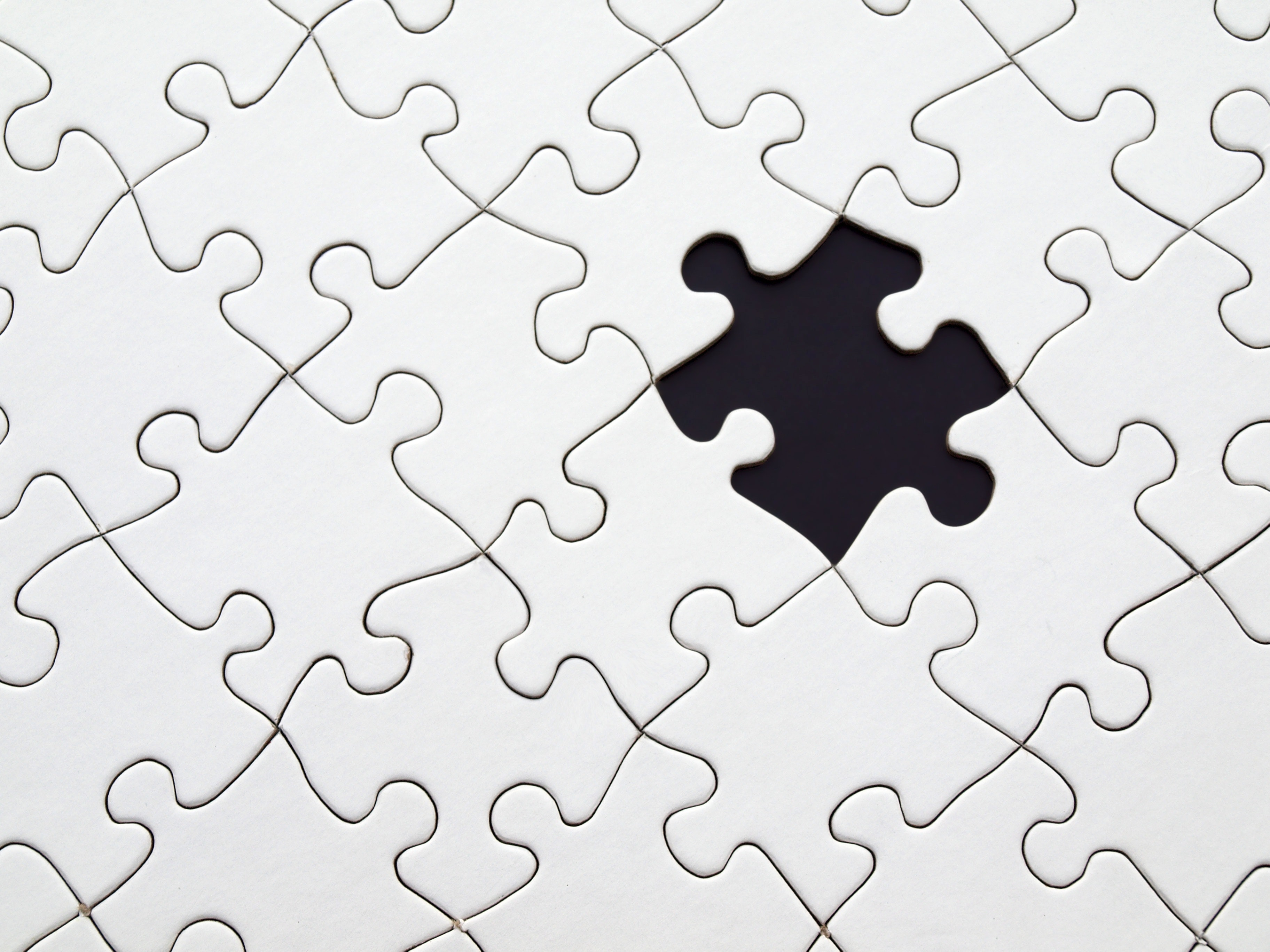 black-and-white-puzzle-pieces-fitting-together